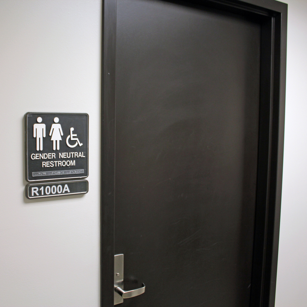 "Public restrooms with ""Gender Neutral"" signs are helpful, but one psychology graduate student describes how ""All Gender"" bathrooms are even more inclusive for TGNC individuals. (Source: ""Gender Neutral Restroom"" by Jeffrey Beall on Flickr. Some rights reserved.)"