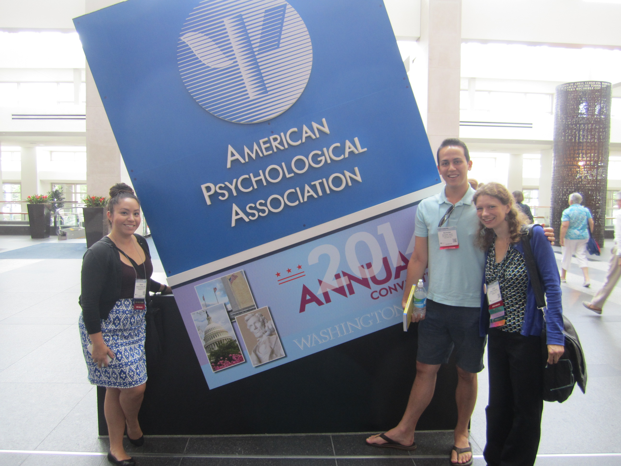 A few members of the committee formerly known as CLGBTC strike a pose at APA's 2014 Convention in DC, from left: Natalie Alizaga, Nick Grant, and Julia Benjamin.