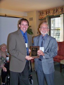 Ray Fowler awarding Mitch Prinstein with the Fowler Award at the 2009 APA Convention, Toronto, ON.