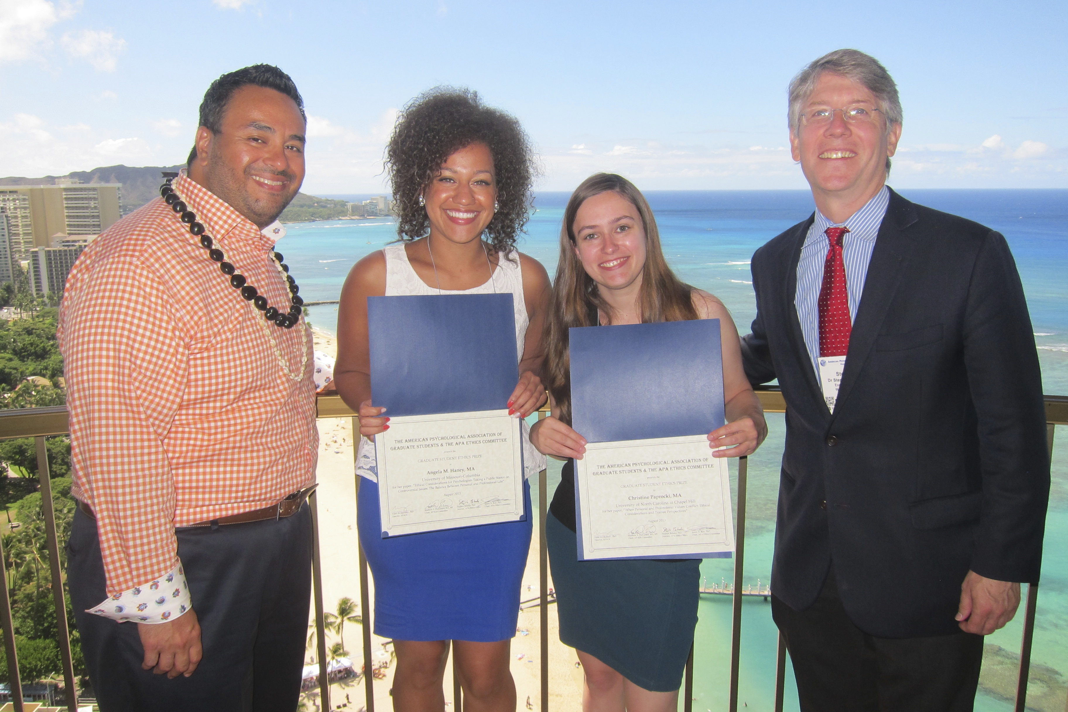 From L-R: Dr. Nabil El-Ghoroury, head of APAGS, stands with winners Ms. Angela Haeny and Ms. Christine Paprocki, and Dr. Steven Behnke, head of the Ethics Office, on the balcony of the APAGS Suite in Honolulu, Hawaii. (Source: APAGS).