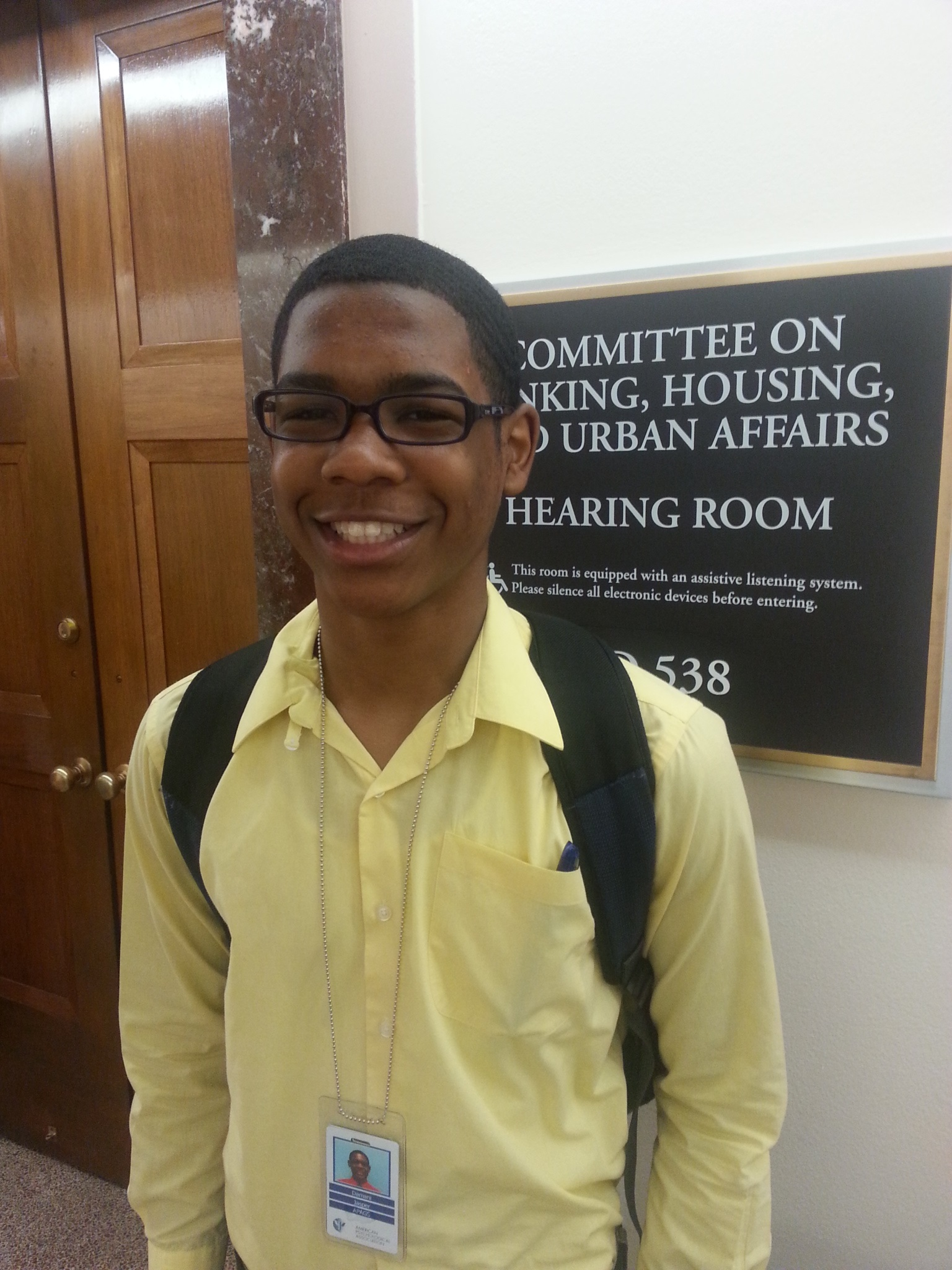 APAGS High School Fellow Damani Jasper outside of a Senate hearing on student debt.