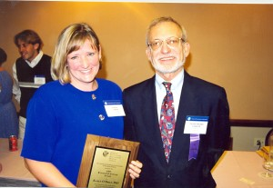 Ray Fowler awarding Karen O'Brien with the Fowler Award at the 1997 APA Convention, Chicago, IL.